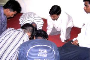 Students praying at a bible seminary in India.